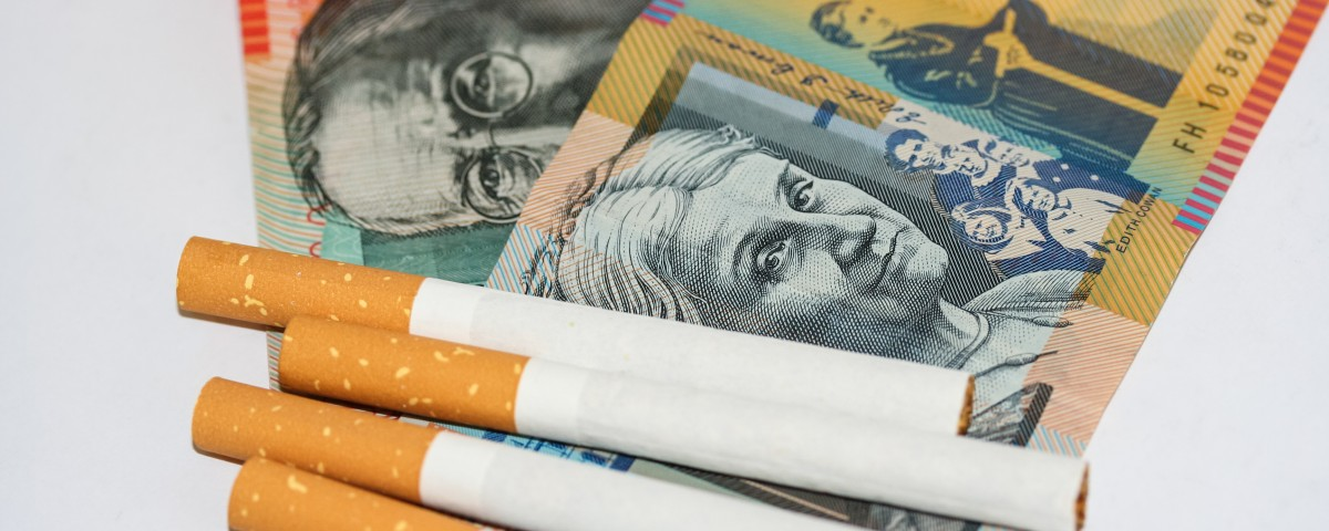 Expensive cigarettes and scattered ontop of piles of Australian money.